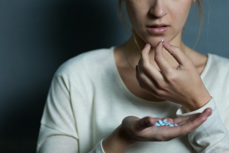 woman pills suicide - habits make anxiety worse
