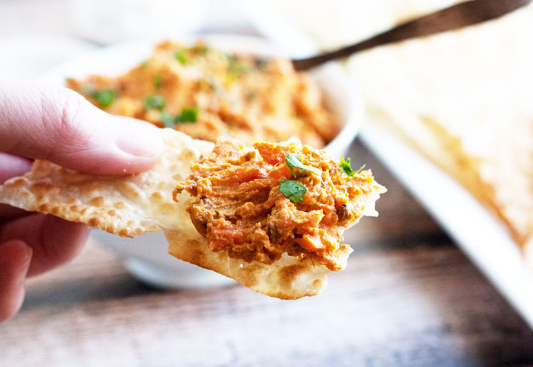 roasted carrot spread on a cracker
